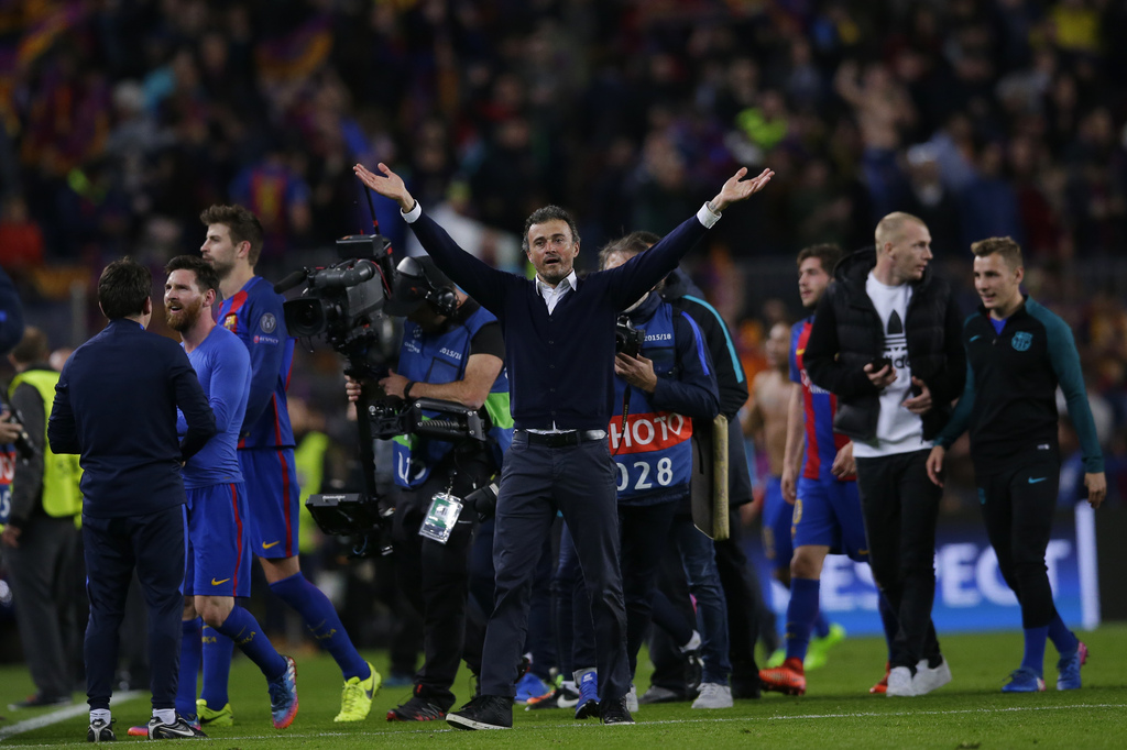 Barcelona's head coach Luis Enrique celebrates at the end of the Champions League round of 16, second leg soccer match between FC Barcelona and Paris Saint Germain at the Camp Nou stadium in Barcelona, Spain, Wednesday March 8, 2017. Barcelona won the match 6-1 (6-5 on aggregate). (AP Photo/Manu Fernandez)