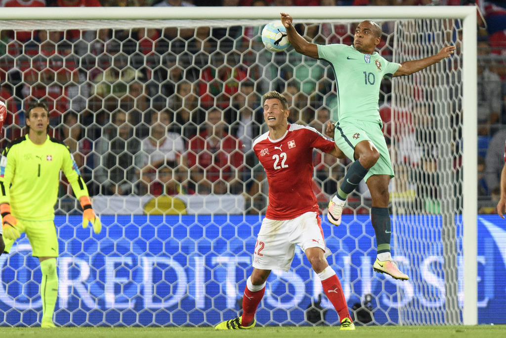 Swiss goalkeeper Yann Sommer, left,and Swiss defender Fabian Schaer, center, fights for the ball with Portugal's midfielder Joao Mario, right, during the 2018 Fifa World Cup Russia group B qualification soccer match between Switzerland and Portugal at the St. Jakob-Park stadium, in Basel, Switzerland, Tuesday, September 6, 2016. (KEYSTONE/Jean-Christophe Bott).