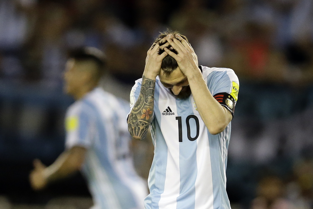 In this March 23, 2017 photo, Argentina's Lionel Messi reacts after missing a chance to score during a World Cup qualifying match against Chile in Buenos Aires, Argentina. Messi has been banned from Argentina's next four World Cup qualifiers, starting with the Tuesday, March 28, 2017 game in Bolivia, for