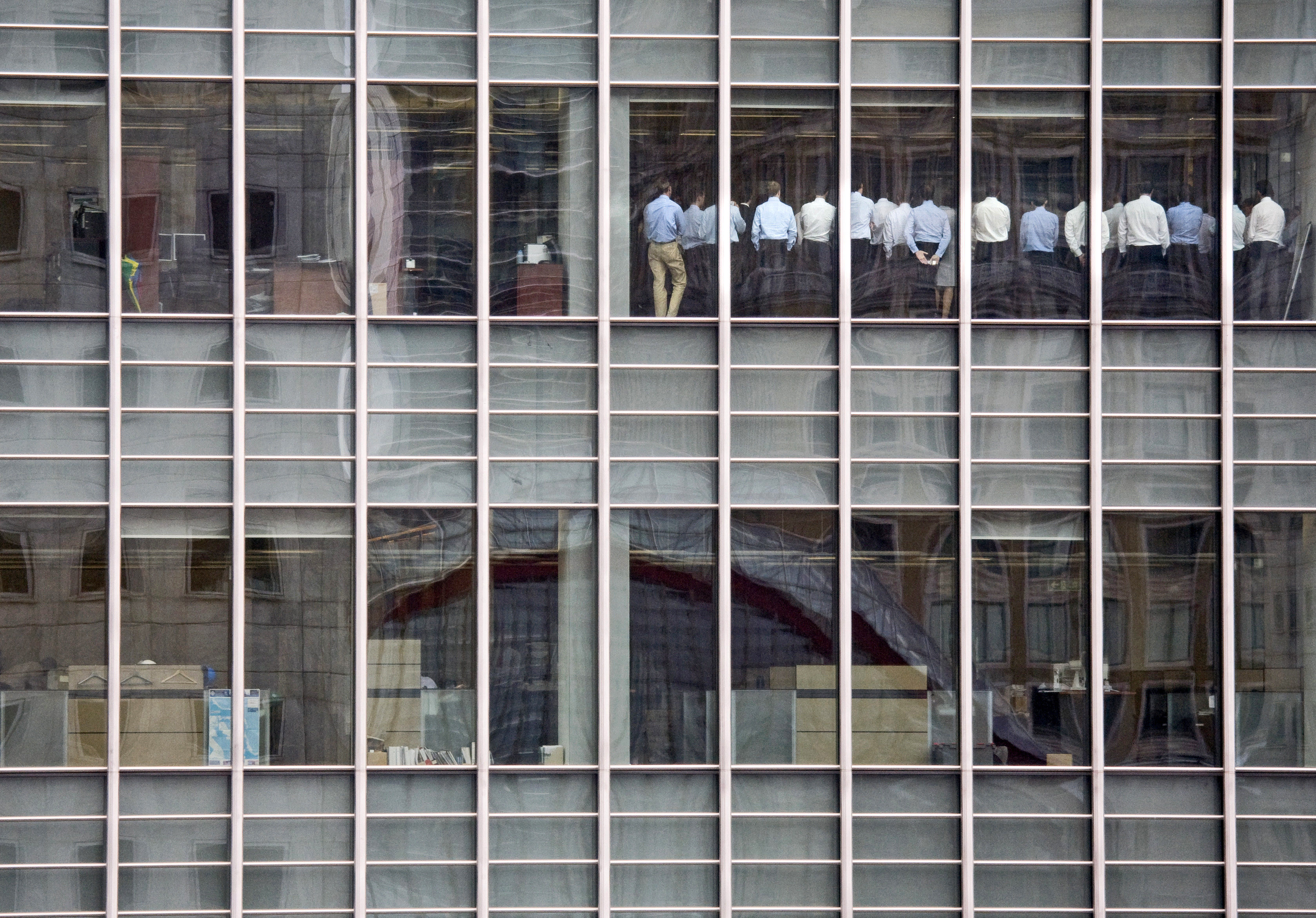 Staff stand in a meeting room at Lehman Brothers offices in the financial district of Canary Wharf in London in this Septembe