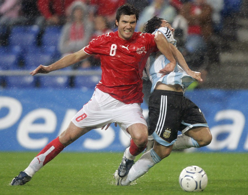 Swiss Raphael Wicky, left, fights for the ball with Argentina's Carlos Tevez, during a international friendly soccer game between Switzerland and Argentina, at St. Jakob Park Stadium in Basel, Switzerland, Saturday, June 2, 2007. (KEYSTONE/Georgios Kefala