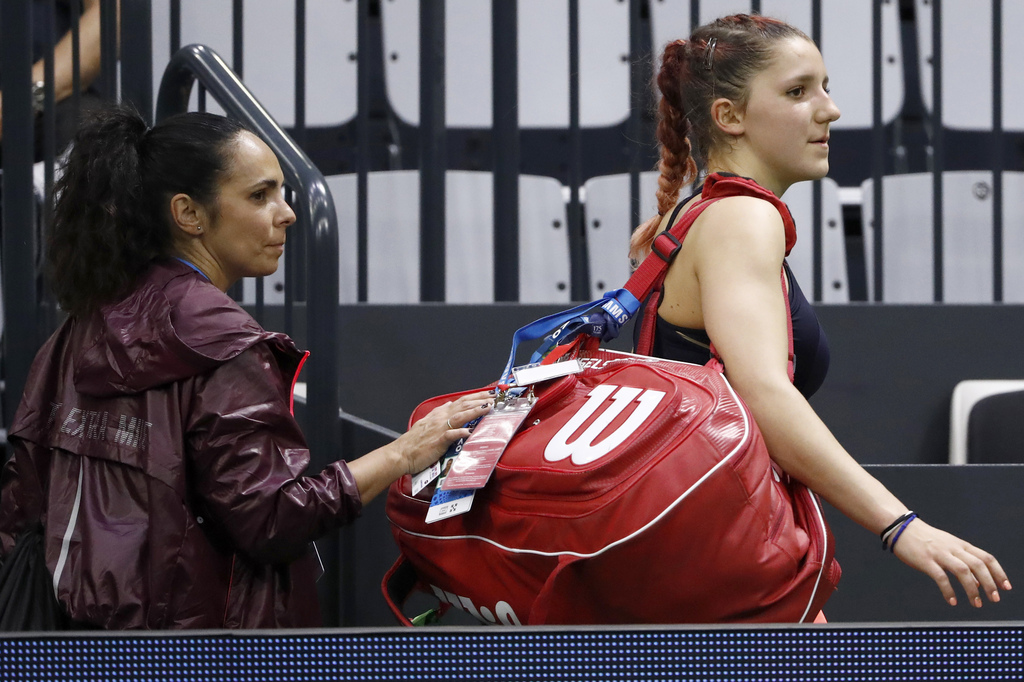 Rebeka Masarova of Switzerland leaves the center court with her coach Maria Victoria Vieites after losing her first round match against Annika Beck of Germany, at the WTA Ladies Open tennis tournament in Biel, Switzerland, Monday, April 10, 2017. (KEYSTONE/Peter Klaunzer)