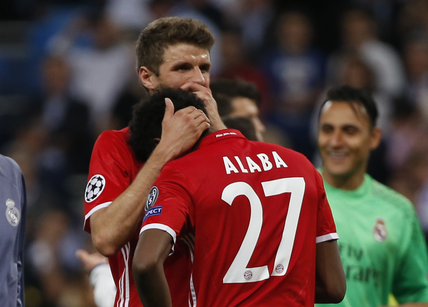 Football Soccer - Real Madrid v Bayern Munich - UEFA Champions League Quarter Final Second Leg - Estadio Santiago Bernabeu, Madrid, Spain - 18/4/17 Bayern Munich's Thomas Muller and David Alaba look dejected after the game Reuters / Susana Vera Livepic
