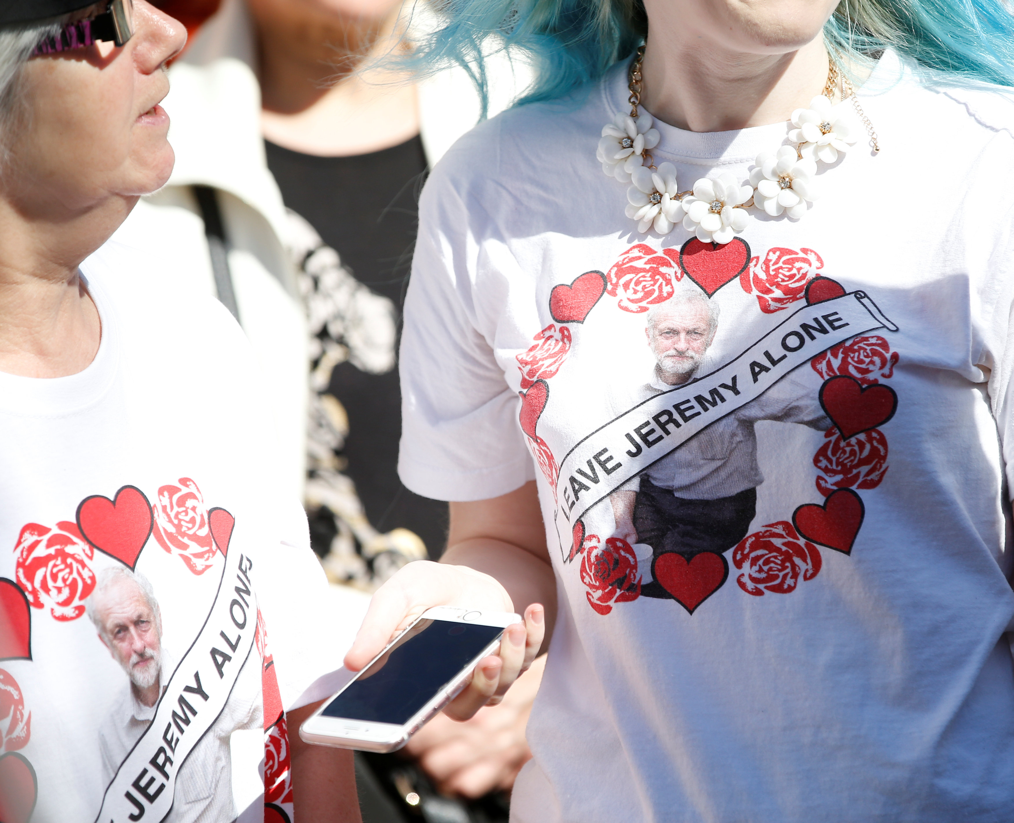 Women wear Jeremy Corbyn t-shirts as Jeremy Corbyn, the leader of Britain's opposition Labour Party, arrives to speak to the public during an election campaign visit in the centre of Crewe April 22, 2017. REUTERS/Andrew Yates