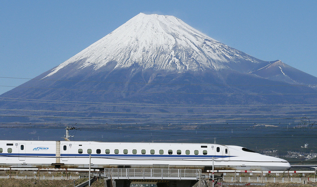 NAGOYA, Japan - Photo taken in November 2013 shows a Tokaido Shinkansen bullet train running with Mt. Fuji on the background