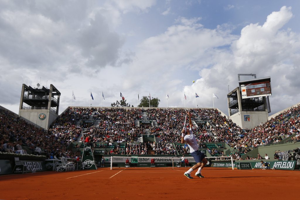 Switzerland's Roger Federer serves against India's Somdev Devvarman in their second round match of the French Open tennis tournament, at Roland Garros stadium in Paris, Wednesday, May 29, 2013. Federer won in three sets 6-2, 6-1, 6-1. (AP Photo/Petr David Josek)