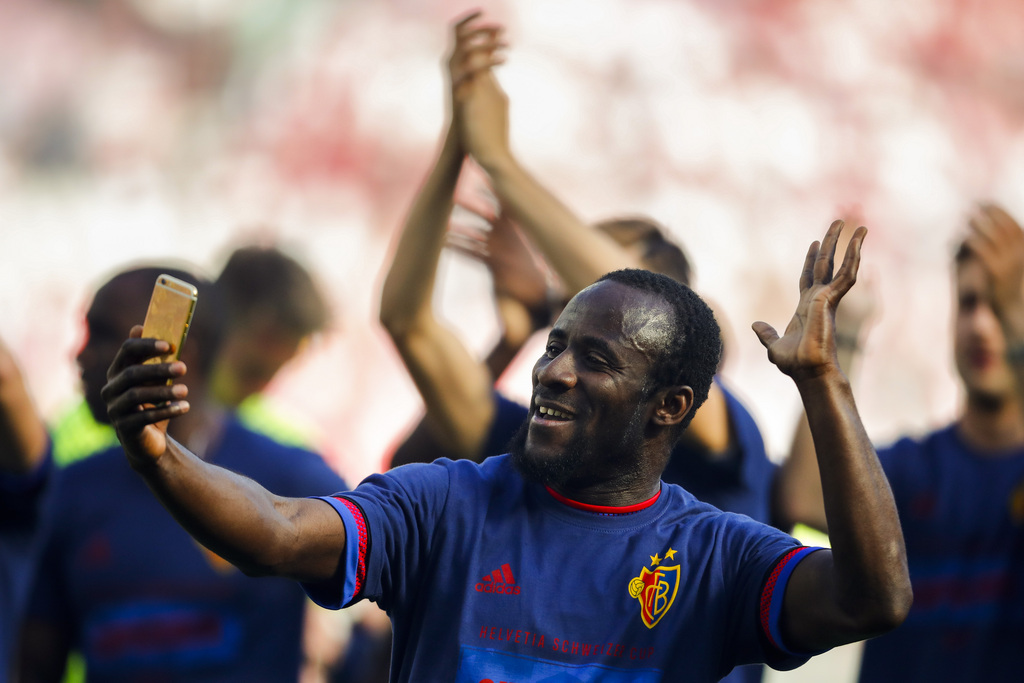 Basel's forward Seydou Doumbia of Ivory Coast takes a selfie as he celebrates his team's ictory after the Swiss Cup final soccer match between FC Basel 1893 and FC Sion at the stade de Geneve stadium, in Geneva, Switzerland, Thursday, May 25, 2017. (KEYSTONE/Valentin Flauraud)