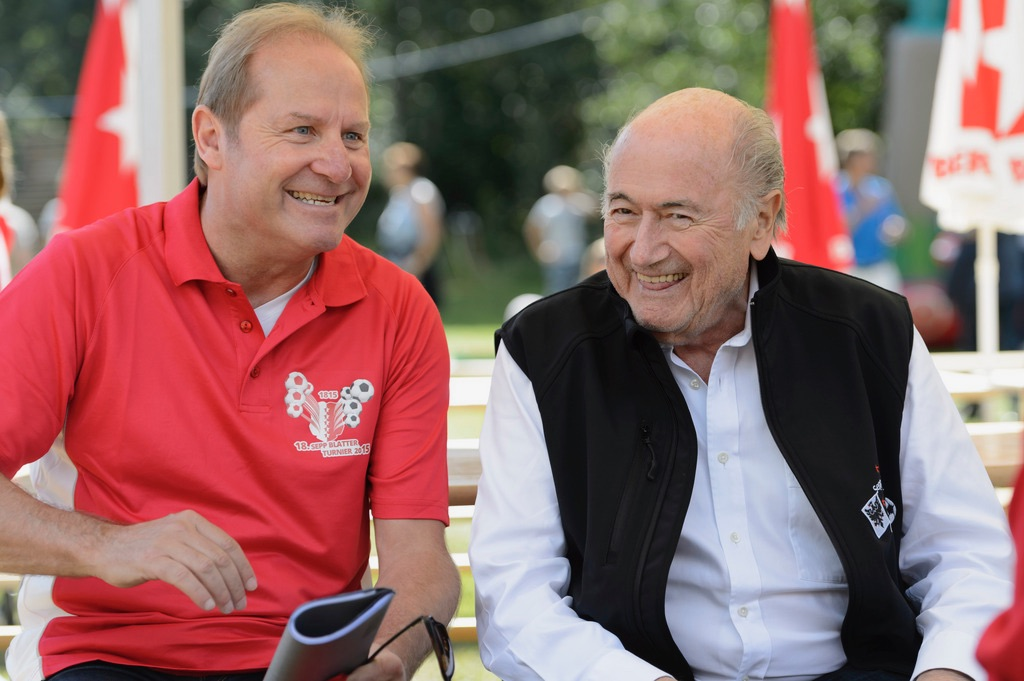 FIFA President, Swiss Joseph Sepp Blatter, right, speaks with former Swiss soccer player Jean-Paul Brigger, left, during the 18th edition of the