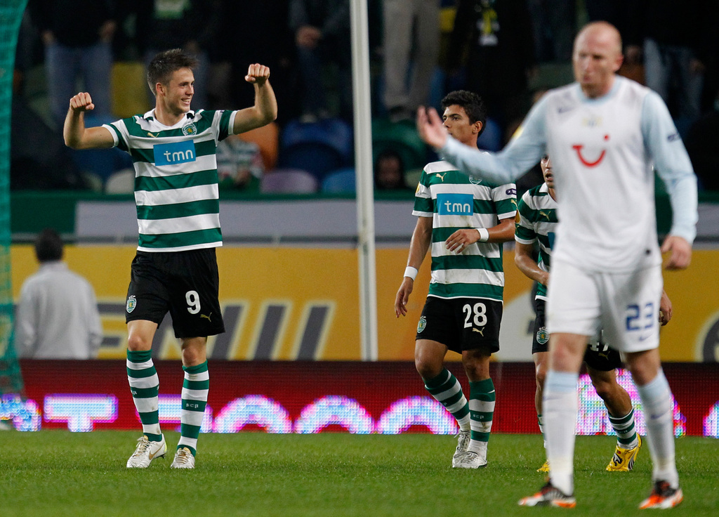 Sporting's Ricky van Wolfswinkel, from the Netherlands, left, celebrates after scoring the opening goal against Zurich during their Europa League group D, soccer match Thursday, Dec. 1 2011, at Sporting's Alvalade stadium. (AP Photo/Armando Franca)