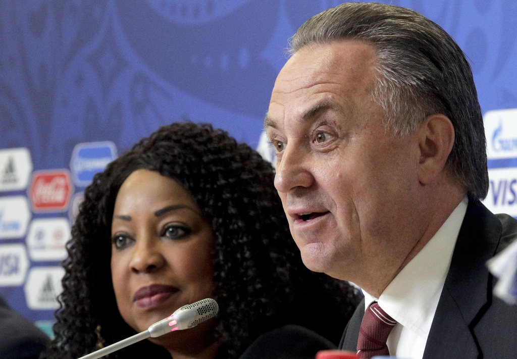 Russian Deputy Prime Minister and Russia World Cup head Vitaly Mutko is flanked by FIFA secretary general Fatma Samoura, left, during a news conference at the St. Petersburg Stadium, Russia, Friday, June 16, 2017. (AP Photo/Dmitri Lovetsky)