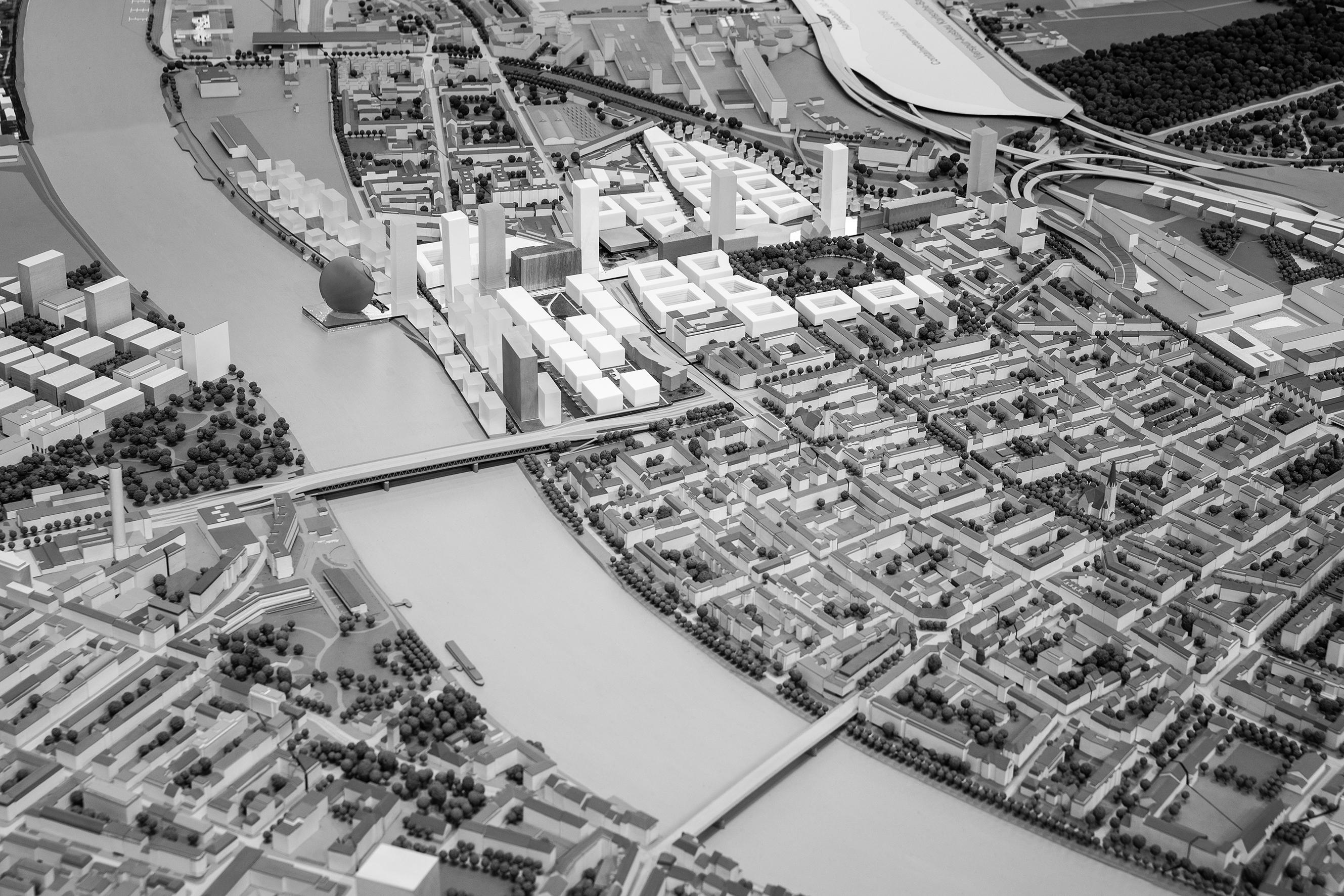 OMA aus Rotterdam durchbrechen das neue Quartier mit einer Kulturmeile.