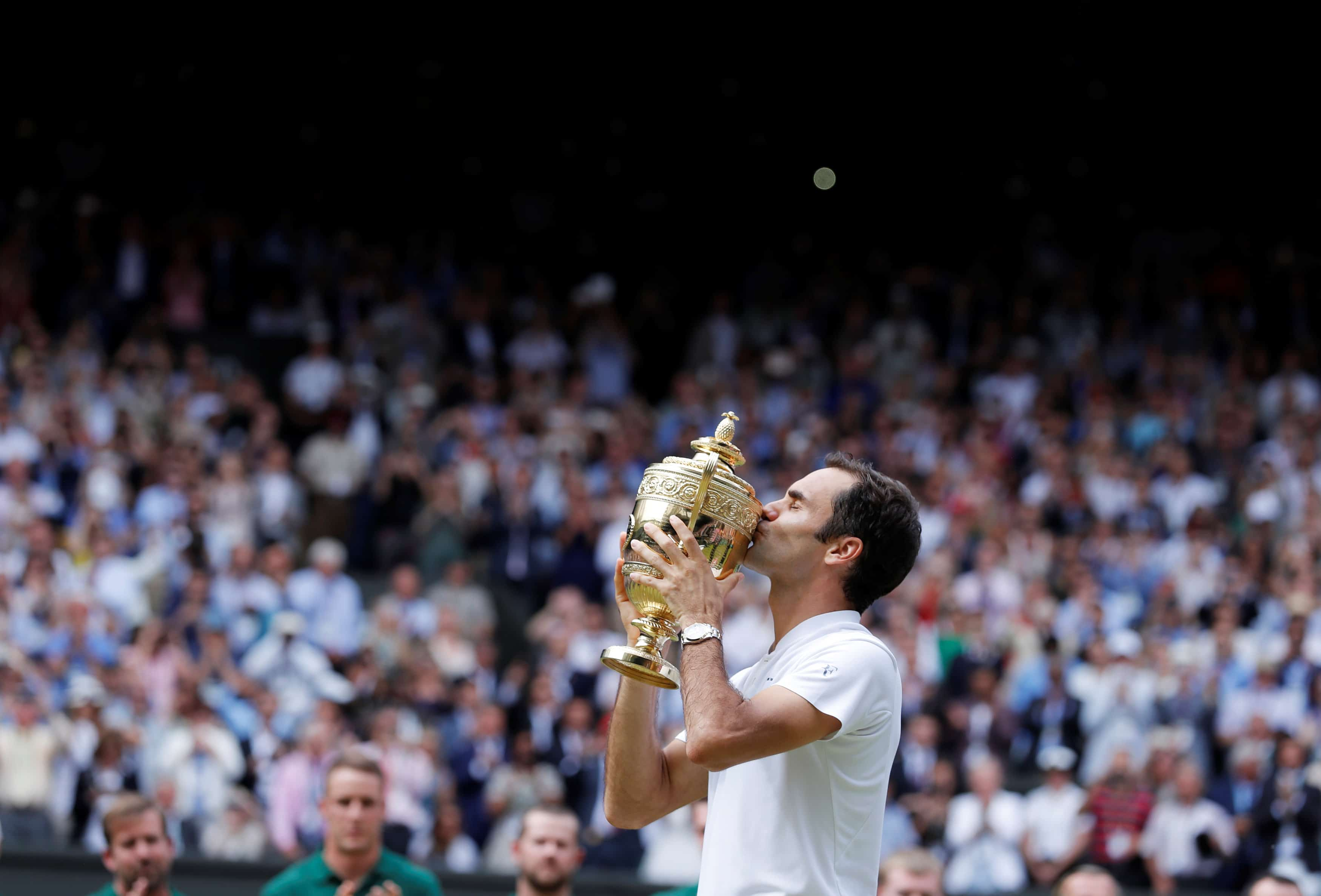 Tennis - Wimbledon - London, Britain - July 16, 2017   Switzerland's Roger Federer poses with the trophy as he celebrates w