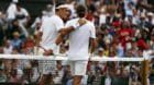 epa06065913 Roger Federer of Switzerland (L) at the net with Alexandr Dolgopolov of Ukraine who retired in their first round
