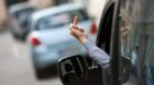 BERLIN, GERMANY  - AUGUST 13: Posed scene, car driver giving another traffic participant his finger on August 13, 2014, in Be