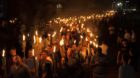 White nationalists carry torches on the grounds of the University of Virginia, on the eve of a planned Unite The Right rally