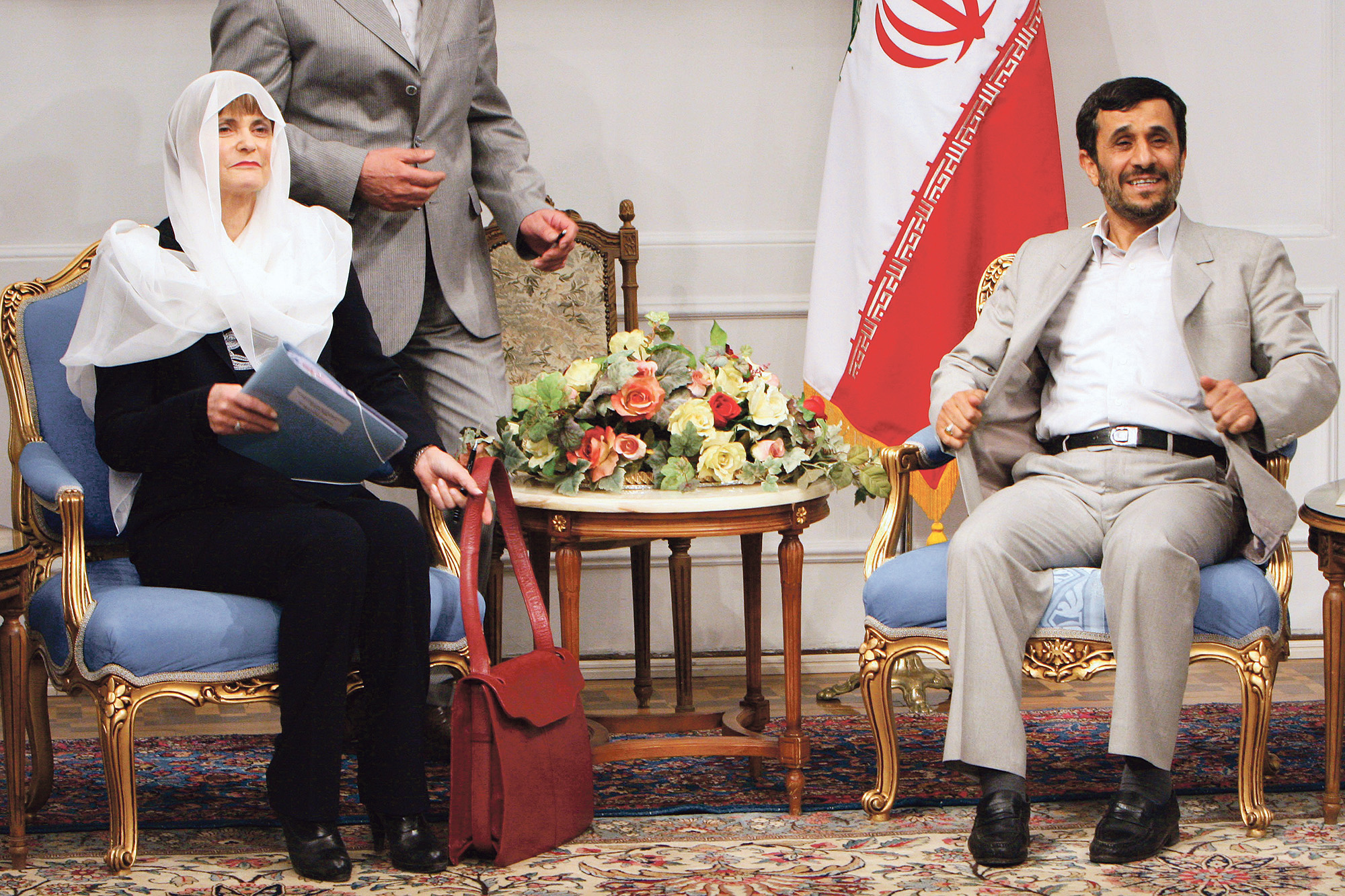 Iranian President Mahmoud Ahmadinejad, right, looks on during a meeting with Swiss Foreign Minister Micheline Calmy-Rey, left
