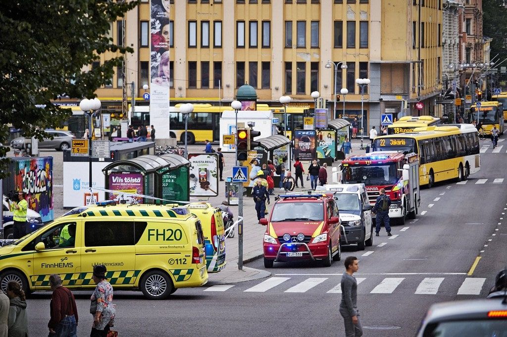 epa06150167 Ambulance cars gather at the site of a multiple stabbing on the Market Square in Turku, Finland, 18 August 2017.