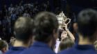 Switzerland's Roger Federer reacts with the trophy after winning the final match against Argentina's Juan Martin del Potro at