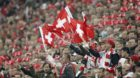Switzerland's fans cheer during the Euro 2012 group G qualification soccer match between Switzerland and England at the St. J