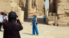 (170917) -- LUXOR (EGYPT), Sept. 17, 2017 -- A Chinese tourist poses for a photo during her visit to the Karnak Temple in Lux