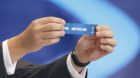 """FIFA Secretary General Jerome Valcke holds up the slip showing """"Switzerland"""" during the draw for the 2014 World Cup at the Co"""