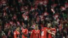Switzerland's players celebrate their qualifying for the 2018 FIFA World Cup Russia after beating Northern Ireland, during th