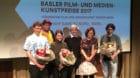 Die vier Preisträger mit Blumensträussen in der Hand (von links): Tobias Koch, Florine Leoni, Nathalie Oestreicher und Stef