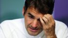 Roger Federer of Switzerland gives a press conference after being beaten in his men's semifinal singles match against Milos R