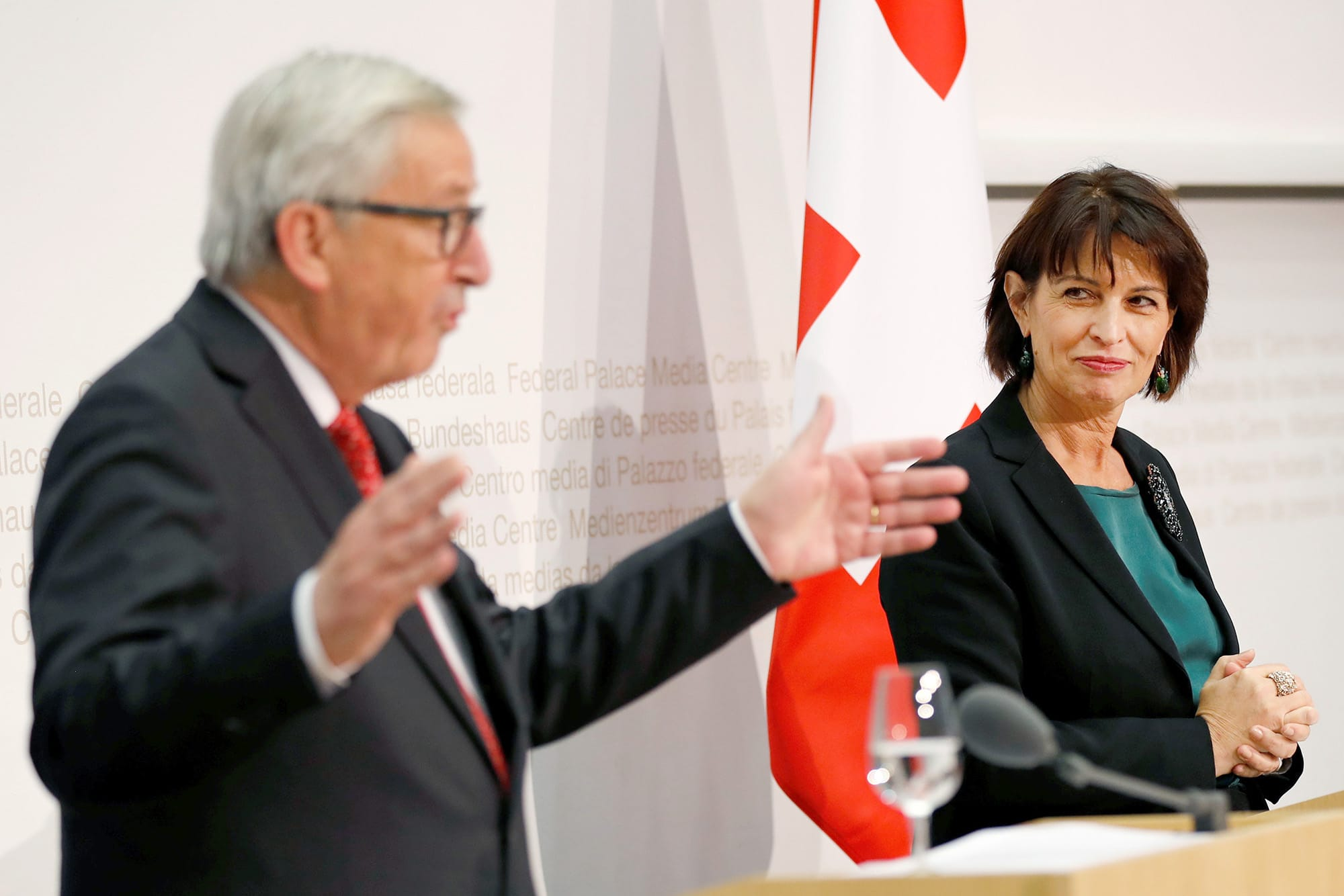 Swiss President Doris Leuthard listens as European Commission President Jean-Claude Juncker speaks during a news conference i
