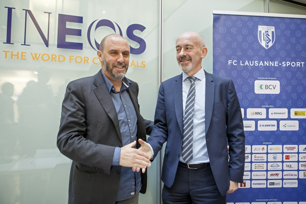 The new president of the FC Lausanne-Sport David Thompson, right, CEO of INEOS, shakes hands with Alain Joseph, left, former