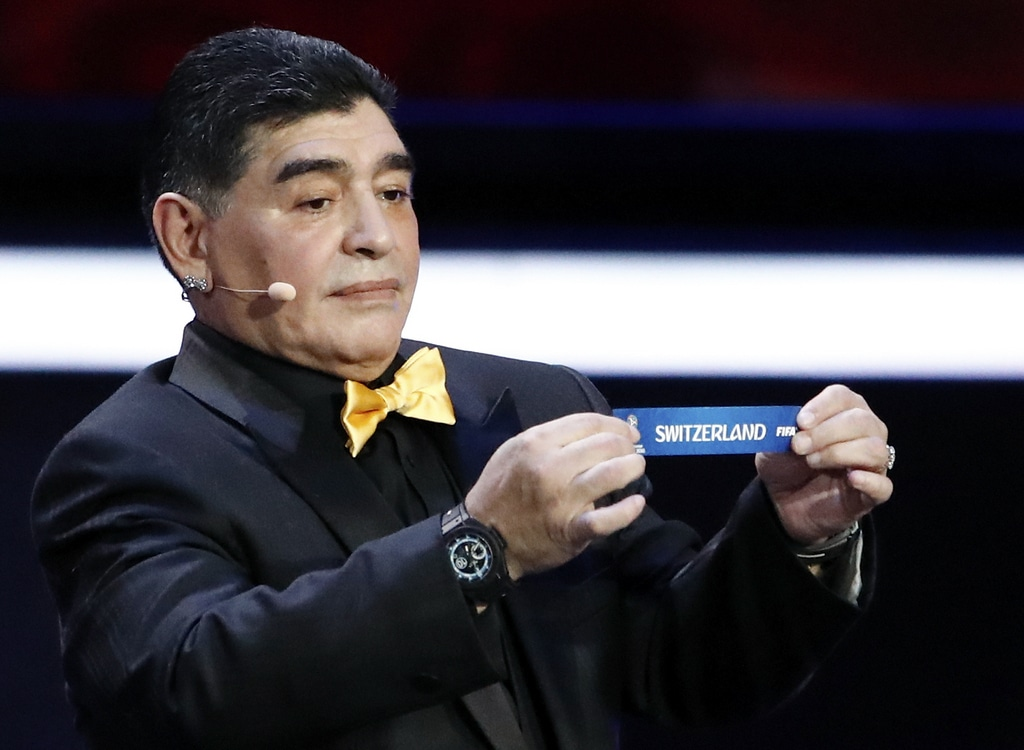 Argentine soccer legend Diego Maradona holds up the team name of Switzerland during the 2018 soccer World Cup draw in the Kre
