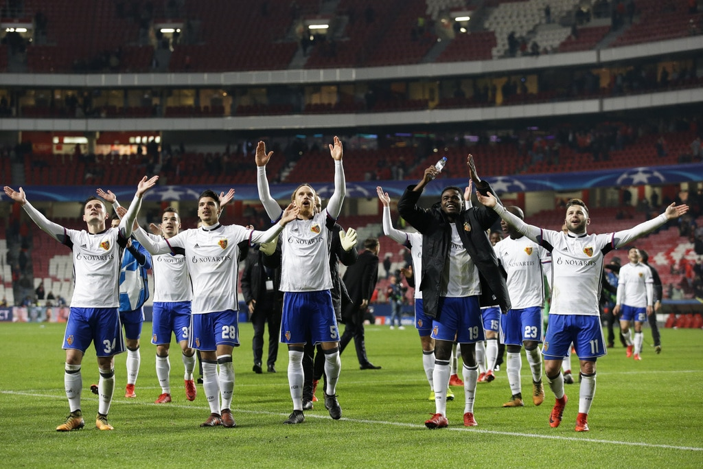 Players of the FC Basel greet supporters after the 0-2 win in the Champions League group A soccer match between SL Benfica an