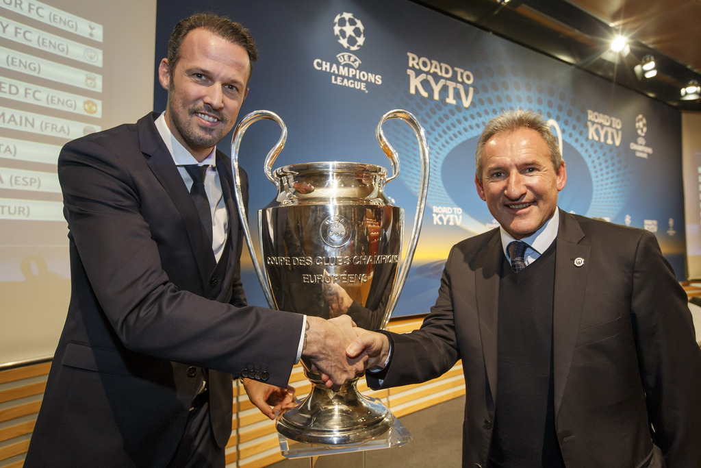 Marco Stroller, left, Sports Director of FC Basel, shakes hands with Txiki Bergiristain, right, Director of Football of Manch