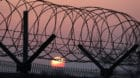 The sun rises over a barbed-wire fence at a military check point on the Unification Bridge, linked to North Korea, near the d