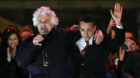 5-Star Movement founder Beppe Grillo (L) speaks next leader Luigi Di Maio during the finally rally ahead of the March 4 elect
