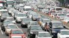Commuters are stuck in a traffic jam during rush hour in Beijing July 9, 2008. Two key measures of pollution in China have fa