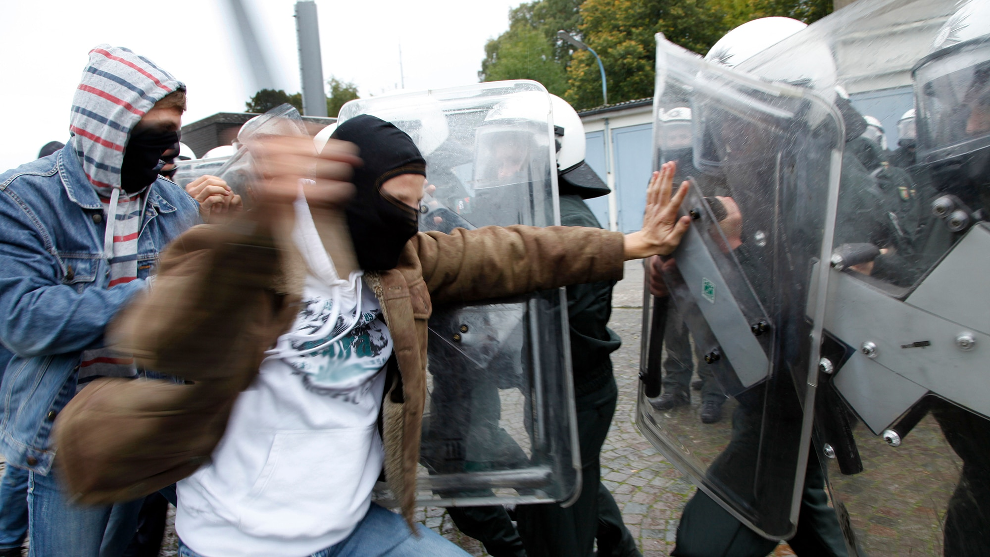 BKCTMX Violence against police officers. Exercise of an anti riot police unit. Violent demonstrators attacks police forces..