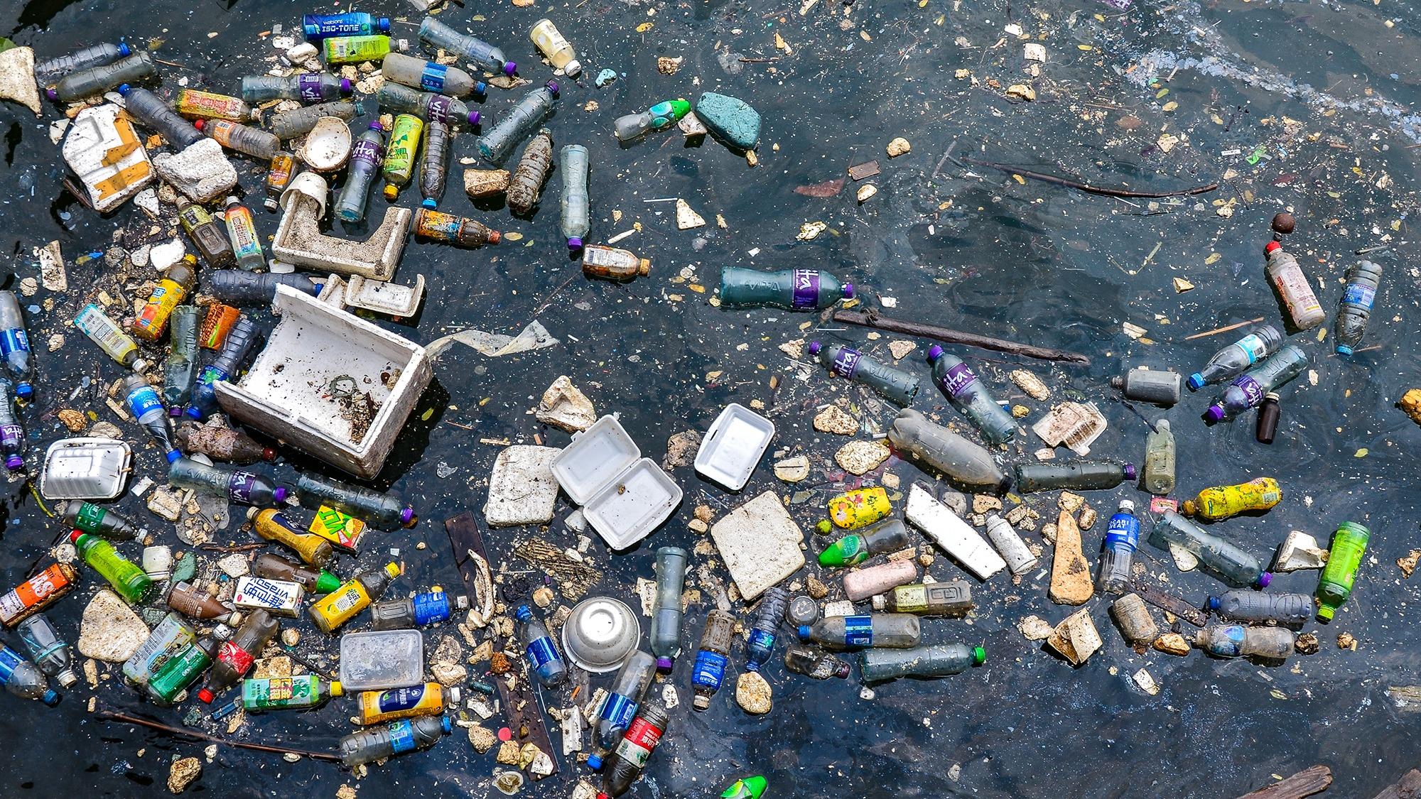 TO KWA WAN, HONG KONG, HONG KONG SAR, CHINA - 2014/07/22: Floating plastic and styrofoam trash polluting a corner of Victoria