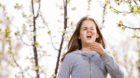 Girl having allergy outdoor. The girl sneezes