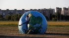 A woman jumps on an inflatable globe outside the stadium in Kaliningrad, Russia, June 28, 2018. As well as shooting all the m
