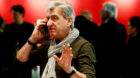 FILE PHOTO: CEO and Chairman of the Board of the Swatch Group Nick Hayek Jr. uses a mobile phone at the Baselworld Watch and