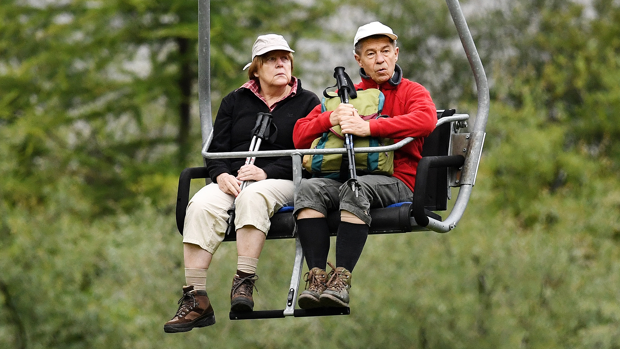EXCLUSIVE PICTURES Angela Merkel and her husband Joachim Sauer are seen on a chair lift during their holidays on July 30, 201