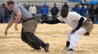 Senegalese wrestler Dieylani Pouye (R) holds an opponent during a fight at a qualification tournament in Romont May 26, 2013.