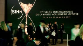 FILE PHOTO: Visitors arrive at the Salon International de la Haute Horlogerie (SIHH) watch fair in Geneva, Switzerland, Janua