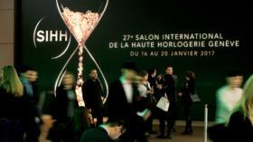 FILE PHOTO: Visitors arrive at the Salon International de la Haute Horlogerie (SIHH) watch fair in Geneva, Switzerland, Janua