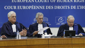 Judges of the European Court of Human Rights sit in the courtroom at the start of an hearing concerning the case of Vincent L