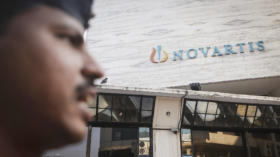 A security guard stands outside the Novartis headquarters building in Mumbai February 6, 2014. Global pharmaceutical firms ar
